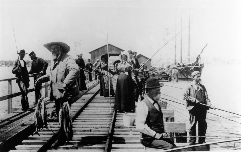old black and white photo of pier