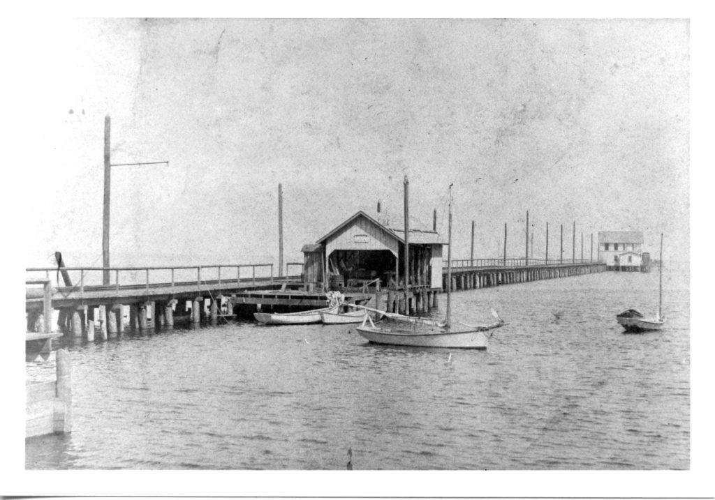 people docking at old electric pier